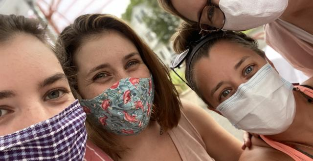 Associate Lori Wilson with her three daughters during the COVID-19 pandemic summer of 2020.