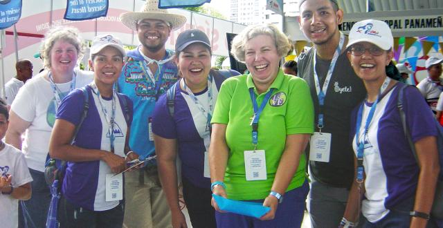 Lisa Buscher, RSCJ, (far left) and Mary Finlayson, RSCJ, (in green) welcoming pilgrims at the Vocation Fair of World Youth Day 2019, Panama.