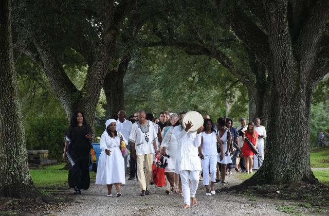 Descendants, RSCJ and guest process to the monuments in the cemetery adjacent to St. Charles Borromeo