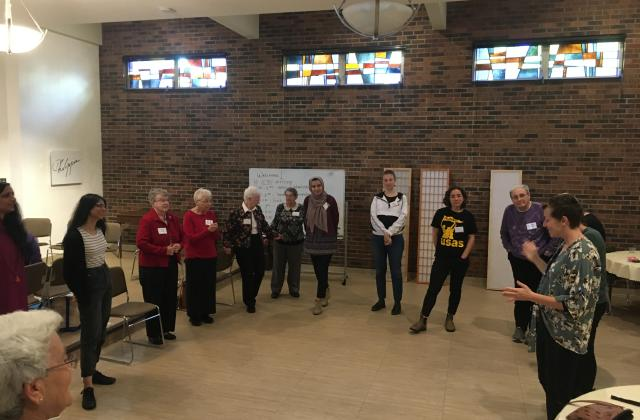 Sisters from several congregations, including RSCJ, gather with young women at the Stuart Center