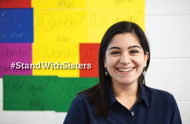 Ani stands with sisters