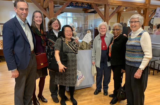 From left to right: Tom Farquhar (Museum Board, Sidwell Friends School Head) Mary Grady (his wife, quilt artist), Susan,  Linda Kato, RSCJ; Calre Pratt, RSCJ; Joan Ewing, RSCJ; Pat Geuting, RSCJ, at the Sandy Spring Museum