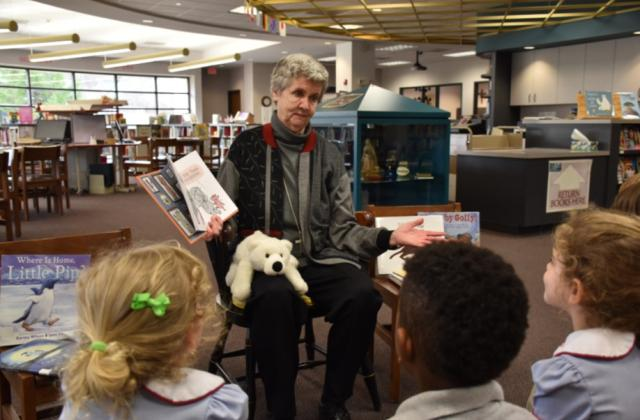Sister Sally Stephens, reading, students, read aloud